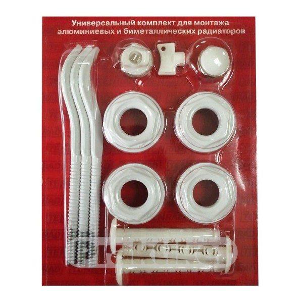 На фото — набор для подключения алюминиевого или биметаллического радиатора. В него входят три кронштейна, четыре проходные пробки (две левые и две правые), заглушка и воздушник (оба с резьбами размером 1/2 дюйма).