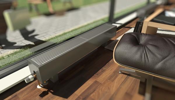 Напольный конвектор создает тепловую завесу перед панорамным окном.