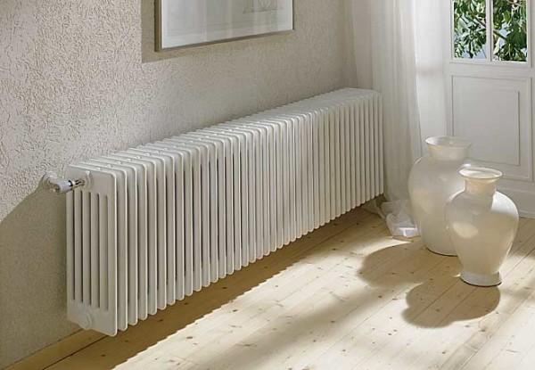 На фото: теплоотдача радиаторов зависит не только от материала их изготовления, но и от того, какой теплоноситель используется в системе