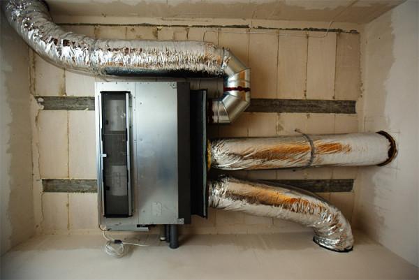 Рекуператор тепла в системе воздушного отопления.